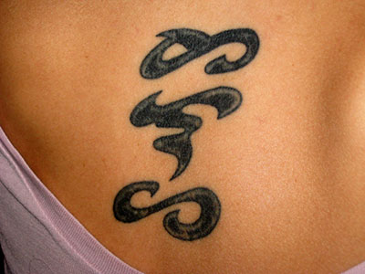 image credit: tattoo by Alex Figueroa. Lucy Burns holds a joint appointment